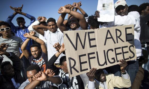 http://lancien.cowblog.fr/images/Images3/Africanmigrantstakepar0141.jpg